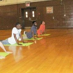 Yoga instructor Irina Kotikova teaches CANY day habilitation participants new poses