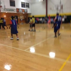 Participants on the court mid game.