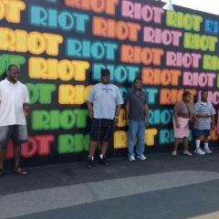 Participants pose in front of Coney Island Art Walls