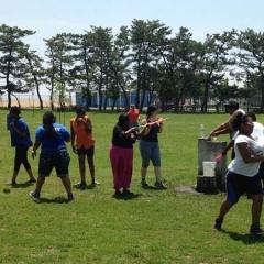 Participants aiming their water guns.