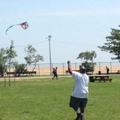 A participant flying a kite.