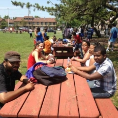 Participants at a picnic table.