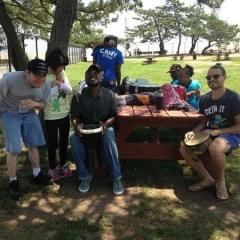 Participants at a picnic table.