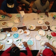 Participants decorating holiday cookies.