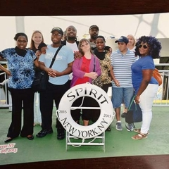 Participants pose with Spirit Cruises life preserver circle.