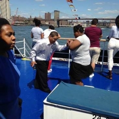 Participants dancing on deck of Spirit Cruises.