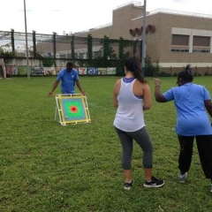 A participant mid-swing trying to git the bullseye target.
