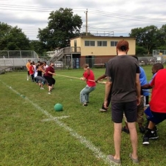 Participants engaged in the game of tug of war.