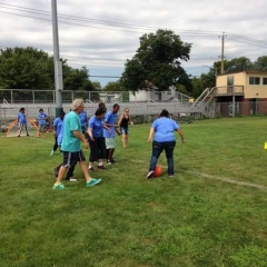 Participants involved in a game of soccer with Respite Director, Mitch Goldstein in the middle of the action.