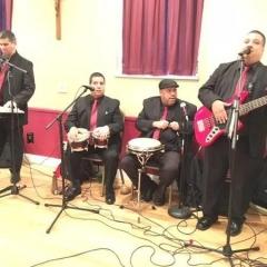 Los Ciegos Del Barrio performing.