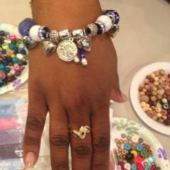 A newly made bracelet on a particpant wrist.