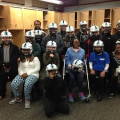 Group of participants posing in team helmets.
