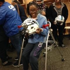 Participant holding Brooklyn Cyclones helmet.