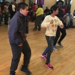 Participants practicing dance moves.