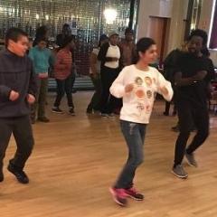 Learning new dance steps.