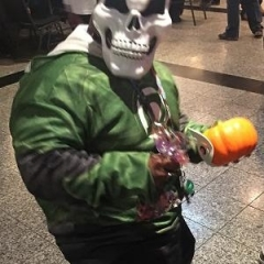 A participant wearing a skull mask poses for a picture.