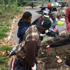 Participants learn how to plant seeds.