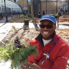 A participant holding up a plant.