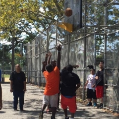 Participants enjoying a game of basketball.