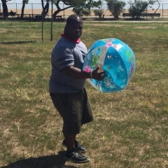A participant holding a large inflatable beach ball.