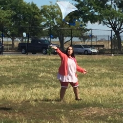 A participant running with a kite.