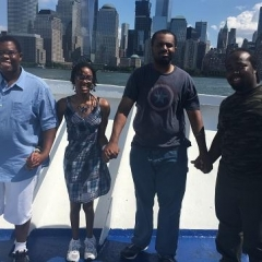 Participants holding hands in front of the New York skyline.