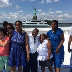 Participants pose in front of Statue of Liberty.