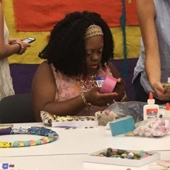 A participant concentrates on making the mural.