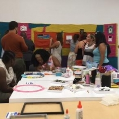 Participants working on the mural.