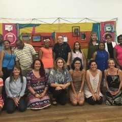 Group picture in front of the mural.