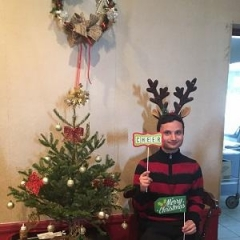 Participant holding up holiday props.