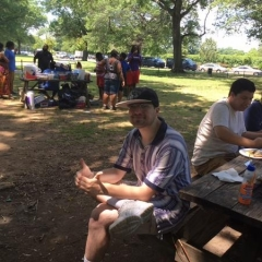 A participant at a picnic table.