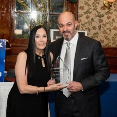 Ilene Rosen, Development & Event Services for City Access and Dr. Frank Mandarino, event honoree. ID: Ilene is handing the award to Dr. Mandarino.