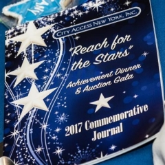 "2017 Gala Journal.  ID:  White stars on a blue background.  The cover reads: ""Reach for the Starts Achievement Dinner & Auction Gala 2017 Commemorative Journal""."