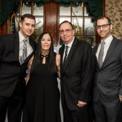 Ilene Rosen poses with family members.  ID: Eric Rosen, event honoree, is on the left.
