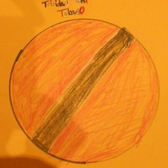 A drawing made for the art contest.  ID: A circle with Trinidad and Tobago flag.