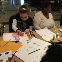 A participant concentrating on her drawing.