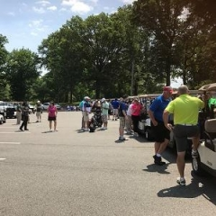 Event participants getting into golf carts.