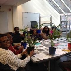 Participants pose with plants.