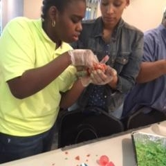 Participants learning to make rice crispy treats.