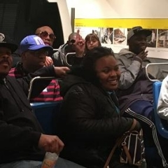 The group participates in a discussion at the Transit Museum.