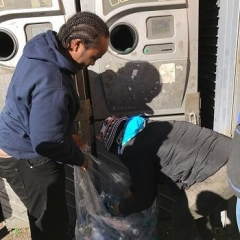 Participants loading recycling machine.