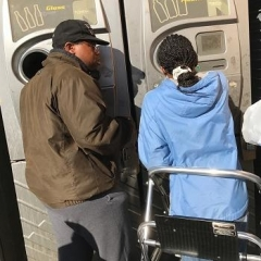 Participants figuring out how to use the recycling machine.