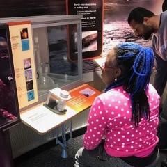 A participant reads about an exhibit.