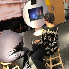 A participant is listening to an educational video.