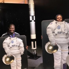 Participants pose with astronaut flight suits.