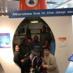 Participants pose in front of Deep Sea exhibit.