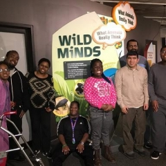 Participants pose in front of Wild Animals exhibit.