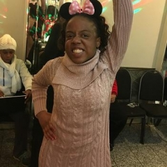 A participant dancing at a Valentine's Day party.