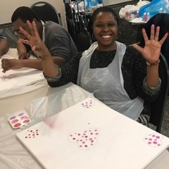 Participant finger painting in preparation for Valentine's Day.